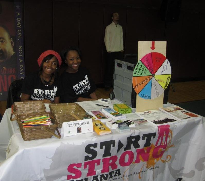 Start Strong Atlanta's teens leaders handed out materials at a youth summit